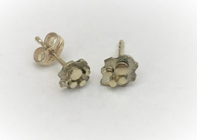 gouden oorknopjes